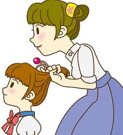 娘の髪をセットする母